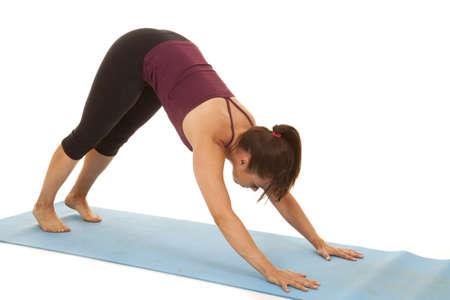 a woman doing some yoga to cool down. photo