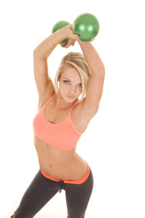 puckered lips: a woman holding on to her fitness balls with her lips puckered