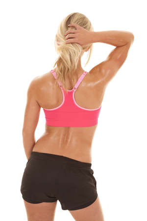 a woman in her fitness clothes showing off her back Stock Photo