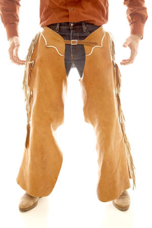A cowboy in chaps standing with his hands ready. Stock Photo