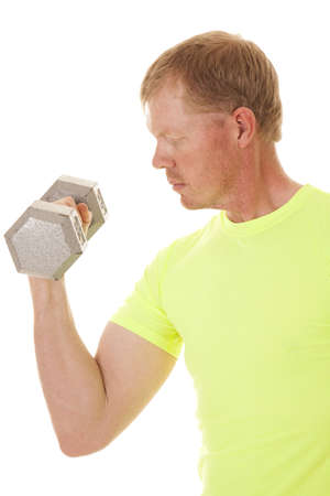 A man curling one weight close up. Imagens