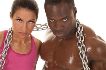 An interacial couple working out with a chain. 版權商用圖片