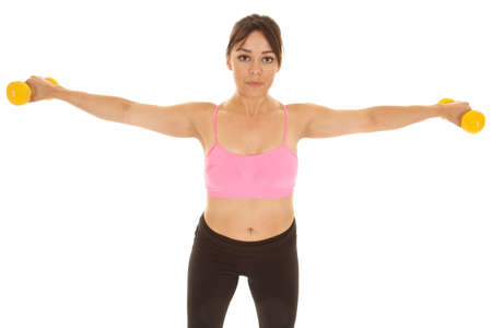 strenghten: A woman working out with weights holding out her arms to strenghten her shoulders.