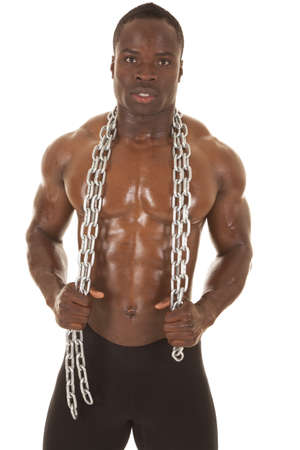 An African American man shirtless holding a chain.