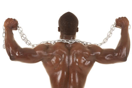 An African American man shirtless holding a chain from the back. photo
