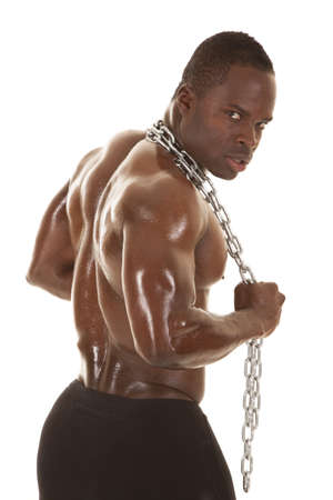 An African American man shirtless holding a chain. Stock Photo - 21268912
