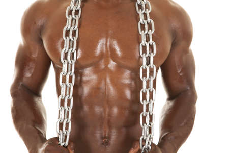 An African American man shirtless holding a chain. photo