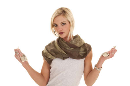 A woman has two fists with money in them. photo