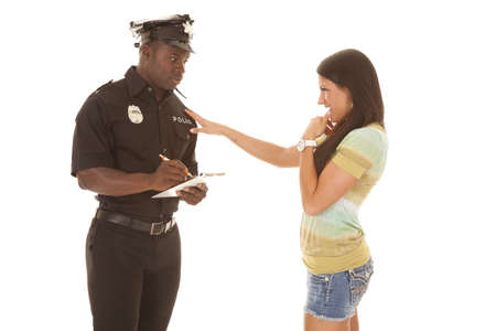 a woman flirting with a policeman to get out of a ticket. Stock Photo