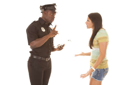 A woman trying to talk her way out of a ticket, that the policeman is going to give her. photo