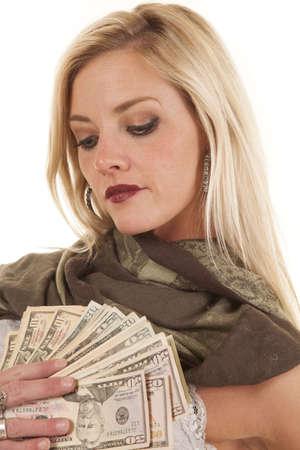A woman is holding a fan of money