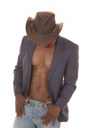 bare chested: A man in his cowboy hat and suitcoat, with a red bow tie and no shirt looking down. Stock Photo
