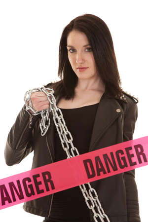 A woman holidng a chain with danger tape. Stock Photo - 21354016