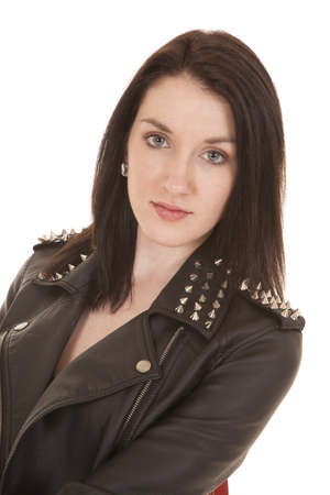 A woman in a leather jacket looking serious. Stock Photo - 21354072