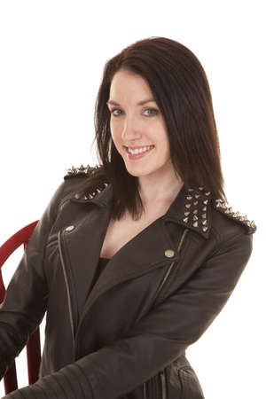 A woman close in a leather jacket smiling. Stock Photo - 21354073