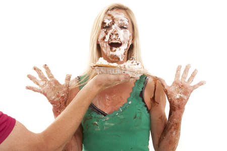 happy faces: A man is throwing a pie in a womans face.