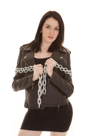 A woman in a leather jacket with a chain around her arms. Stock Photo - 21354082