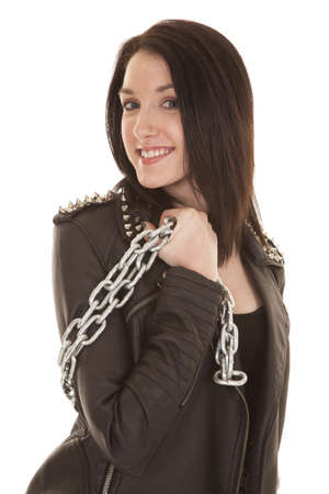 A woman in a leather jacket holding chain to the side. Stock Photo - 21354083
