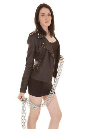 A woman in leather jacket standing with chains. Stock Photo - 21354084