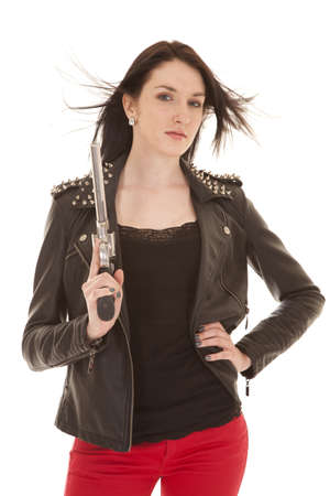 A woman in a leather jacket holding a gun. Stock Photo - 21354085