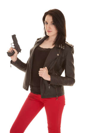 A woman holidng up a gun looking. photo