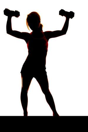 Una mujer es el levantamiento de pesas en el aire siluetas