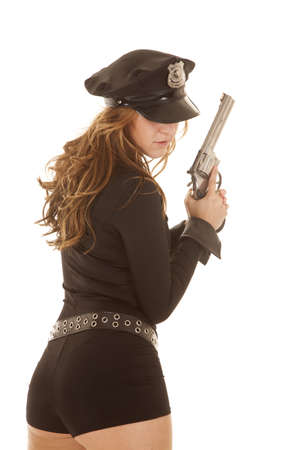 A woman police officer from the back with a gun. photo