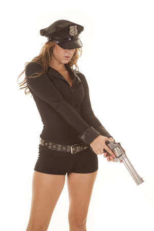 A woman cop holding a gun looking down. photo