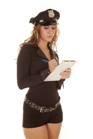 A woman cop is writing a ticket. Stock Photo