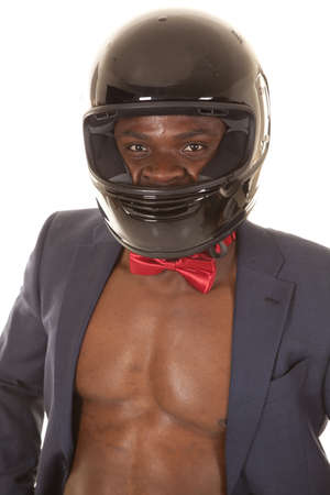 bare chested: A close up of a man in his business jacket, with a red bow tie, wearing his motorcycle helmet. Stock Photo