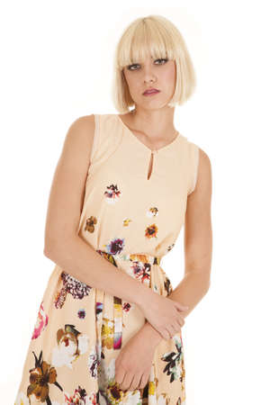 fair woman: A woman in a flower dress standing looks serious. Stock Photo