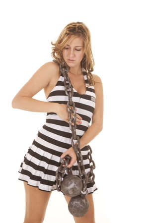 inmate: A woman prisoner with a chain around her.