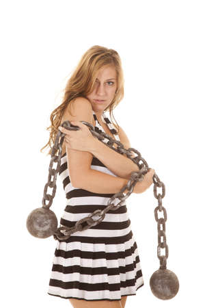 inmate: A woman with a chain around her looking serious.