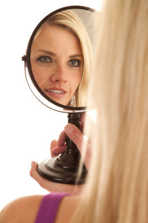 A woman up close looking into a mirror photo