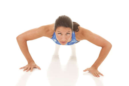 push: a woman is working out doing a push up.