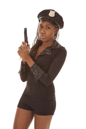 A black woman is holding a gun dressed as a cop photo