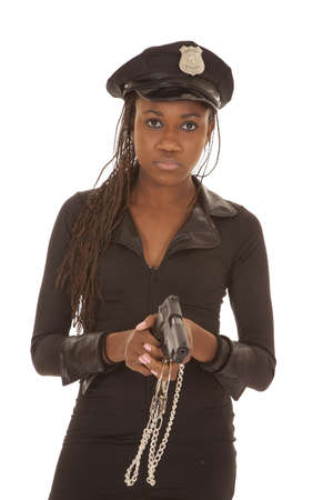 An African American woman cop with a gun. photo
