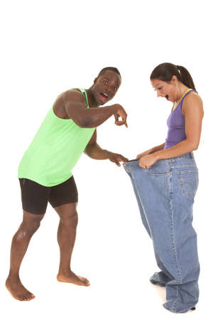 A man holding on to  a womans pants with shocked expressions on their faces. photo