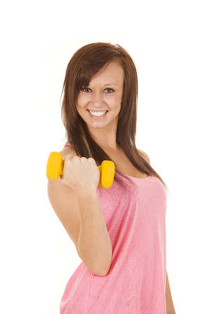 A woman working out with her weights with a smile on her face. Stock Photo