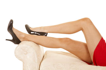 A womans legs in her red dress and heels