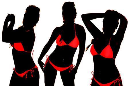 A woman in three positions in a bikini silhouette Stock Photo