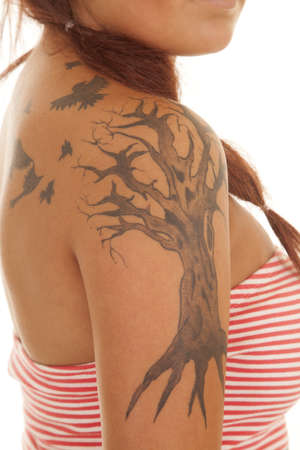 A woman close up of arm with tattoos. photo