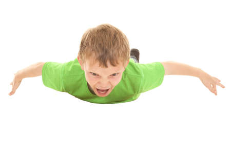 freaked: a boy flying through the air with a happy freaked out expression on his face. Stock Photo