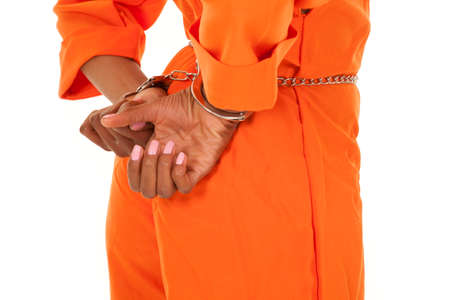 A close up of a womans hands in handcuffs.