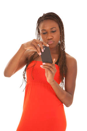 a woman looking at her cell phone with a serious expression on her face. photo