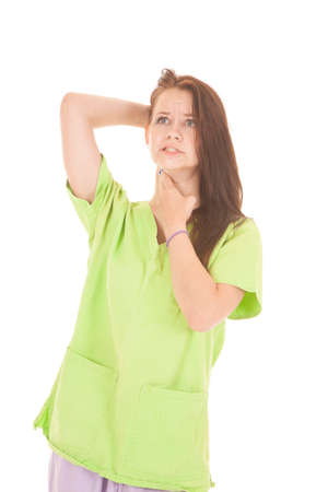 A woman is checking her own pulse on her neck.