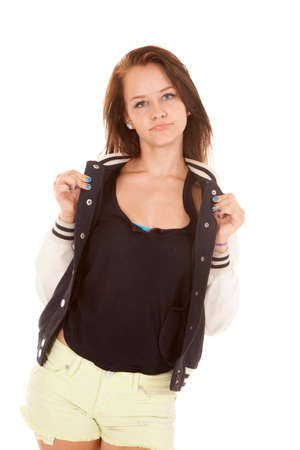 half dressed: A girl is holding the collar of her jacket.