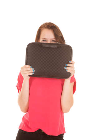 A girl is peeking over a computer case. photo