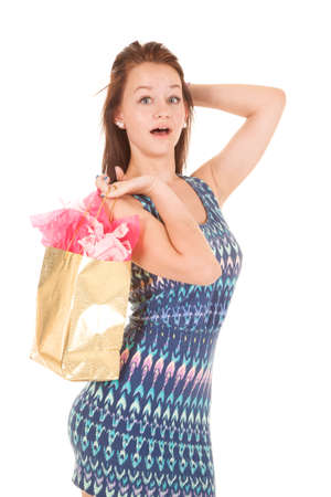 A teen girl is holding on to a gift bag. photo