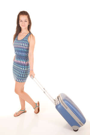 A teen is walking with her luggage. Stock Photo - 22205602